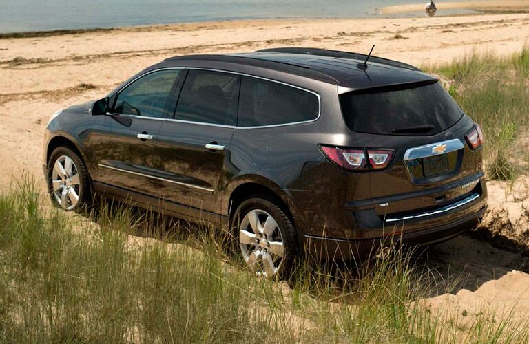 Black 2015 Chevy Traverse parked on a beach.