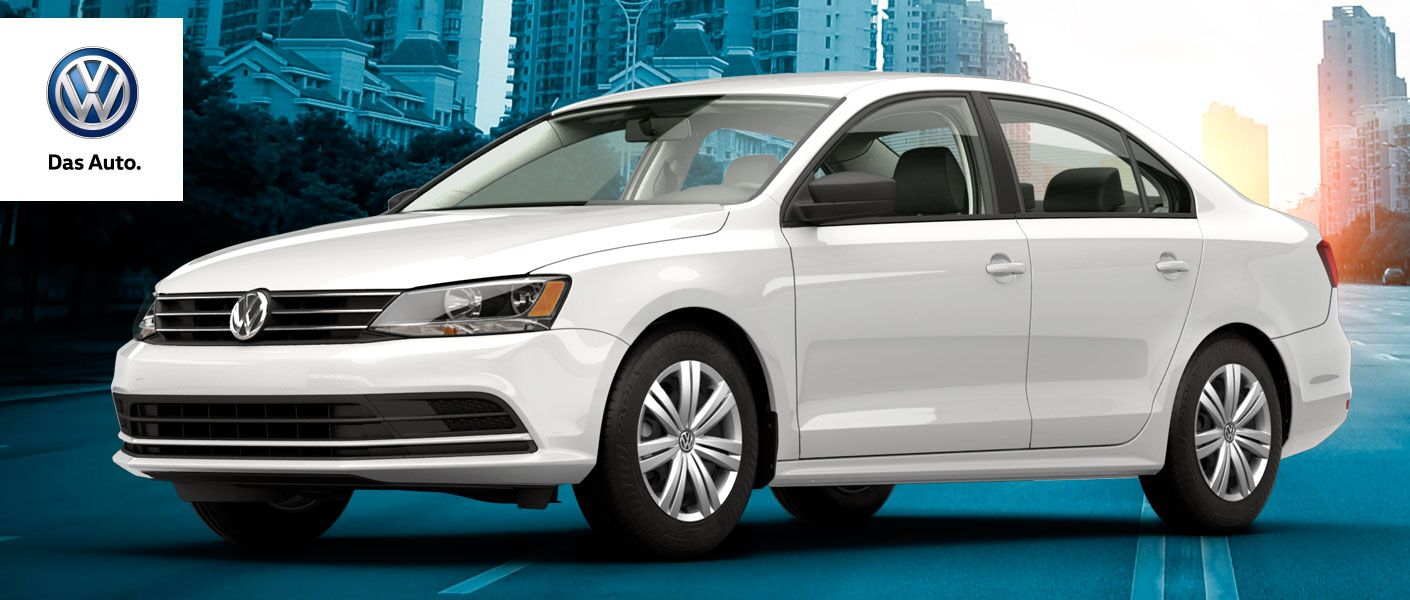 "White Volkswagen Jetta TDI parked in a futuristic environment. A VW logo in the upper-left corner says, ""Das Auto."""
