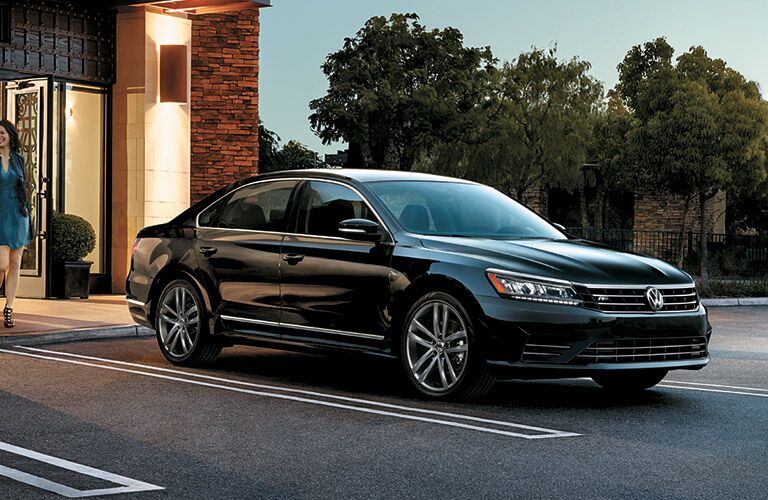 black 2016 VW Passat parked