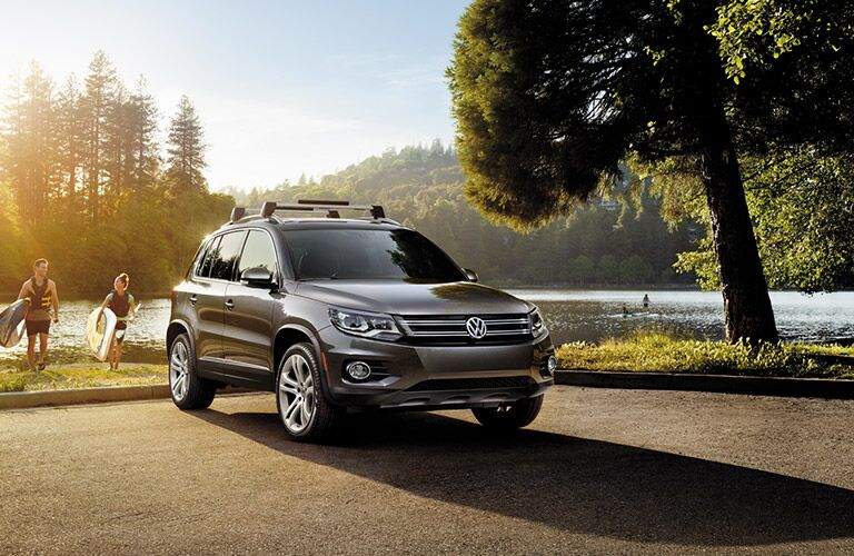 2016 Volkswagen Tiguan parked by a lake as the sun sets.