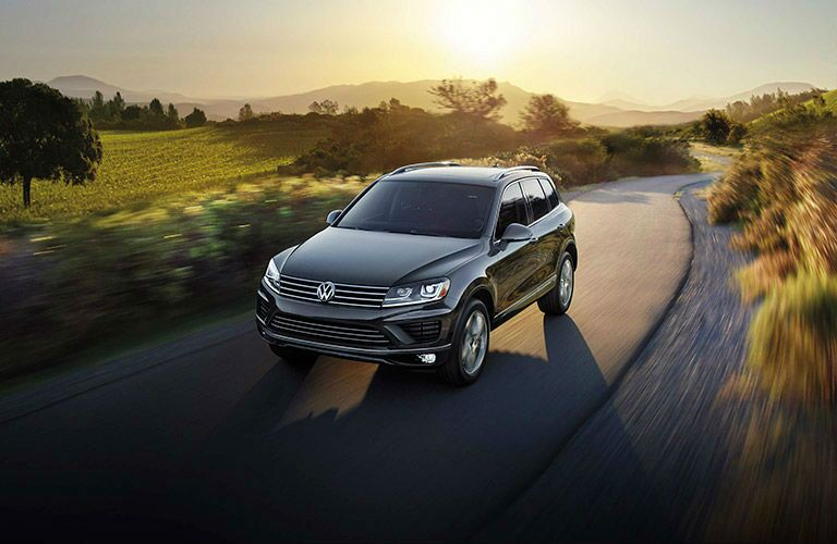 The 2016 Volkswagen Touareg cruises a sun-lit highway.