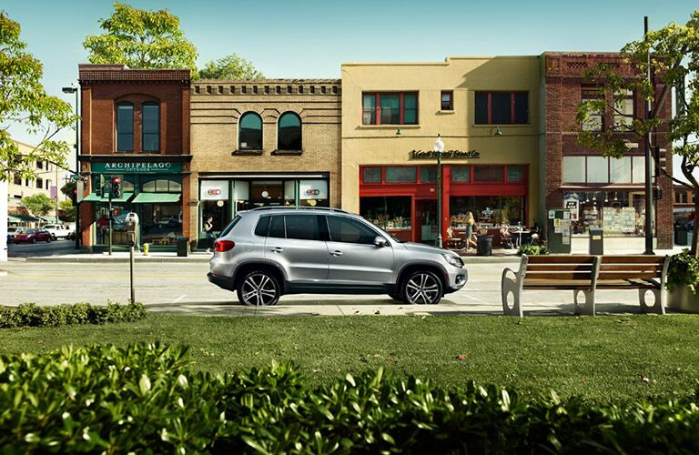 silver 2017 Volkswagen Tiguan parked at bench