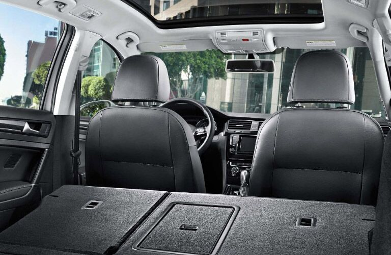 Rear cargo area with lowered rear seats in 2017 Volkswagen Golf Sportwagen.