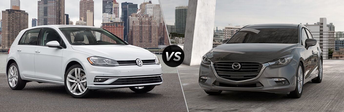 Front Quarter profile of the 2018 Volkswagen Golf parked by a cityscape vs 2018 Mazda3 parked on a parking ramp overlooking a city