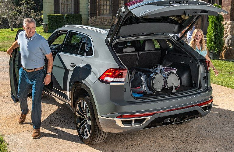 Open cargo hatch with belongings of a 2020 VW Atlas Cross Sport