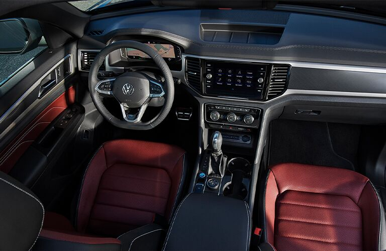 Interior front cabin with red seats of a 2021 Atlas Cross Sport