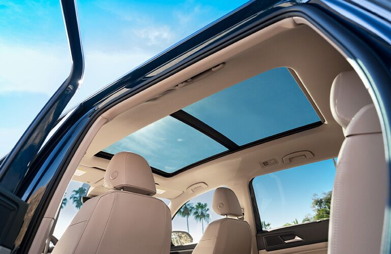 Gazing up at the panoramic sunroof inside a 2021 VW Atlas