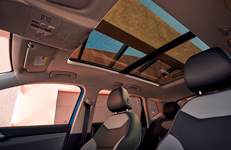 Seats and panoramic sunroof inside 2022 Volkswagen Taos