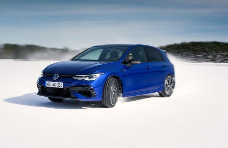 Blue 2022 Volkswagen Golf R in snow