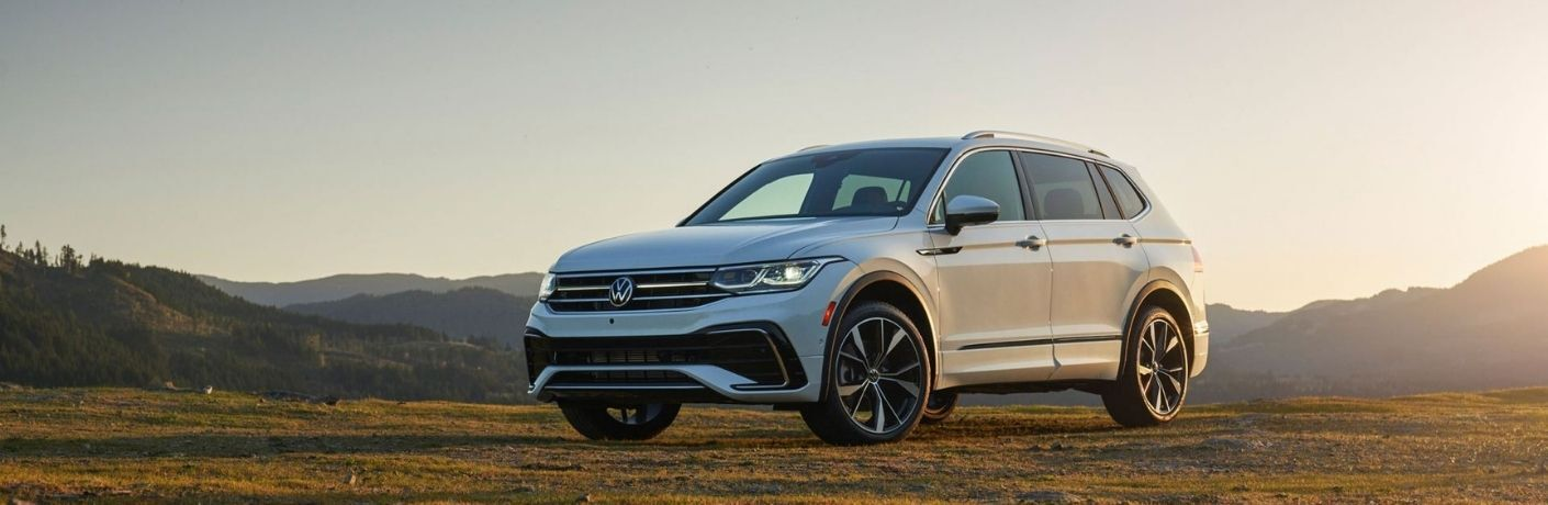 A 2022 Volkswagen Tiguan parked on a plain field.