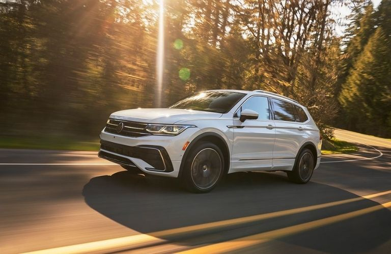 A 2022 Volkswagen Tiguan driving on the highway.