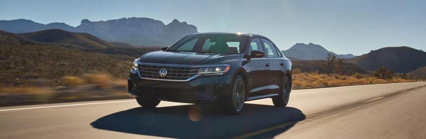 A 2022 Volkswagen Passat driving on the highway.