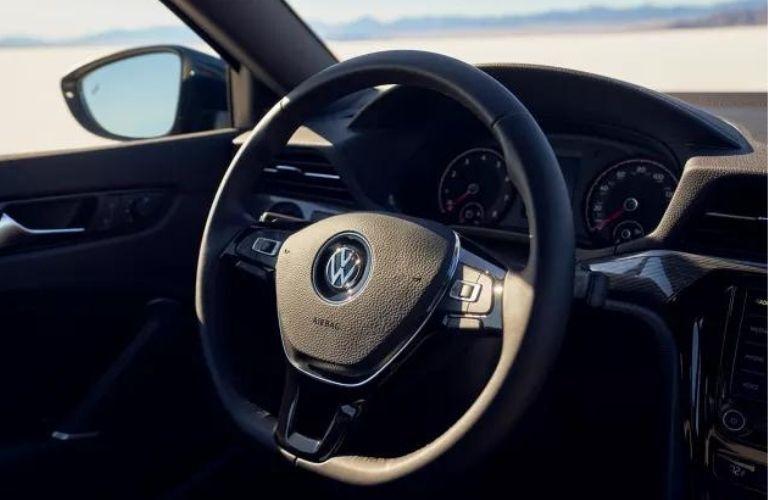 The steering wheel of the 2022 Volkswagen Passat.
