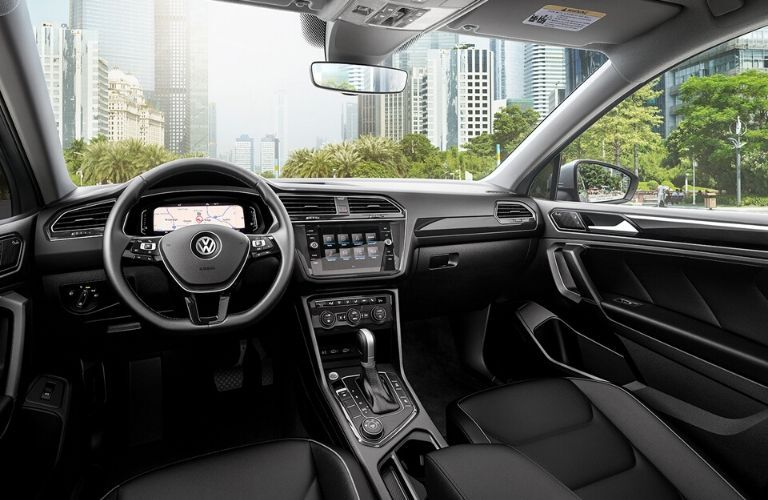 Interior of 2019 VW Tiguan showing dash, wheel and more