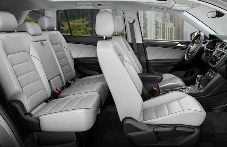 Interior showiing front and back seats of 2019 VW Tiguan from passenger side