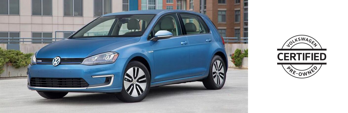 """Blue Volkswagen Golf model next to a logo that reads, """"Volkswagen Certified Pre-Owned"""""""