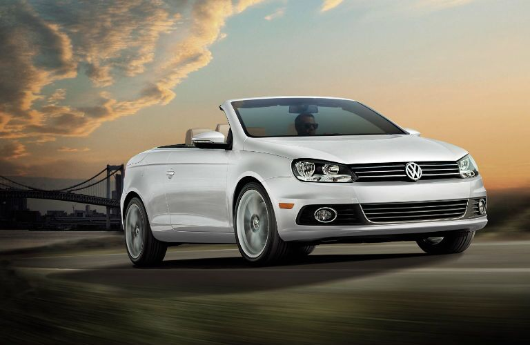 A white 2016 VW Eos with the sunset behind it.