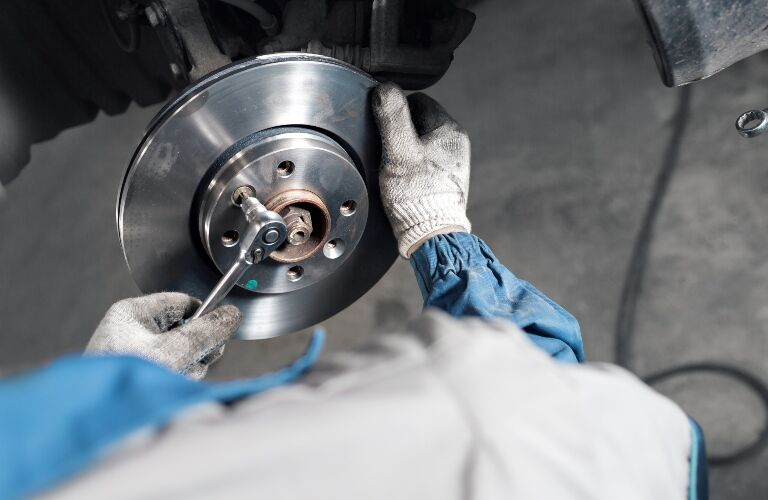 tech operating on a brake rotor