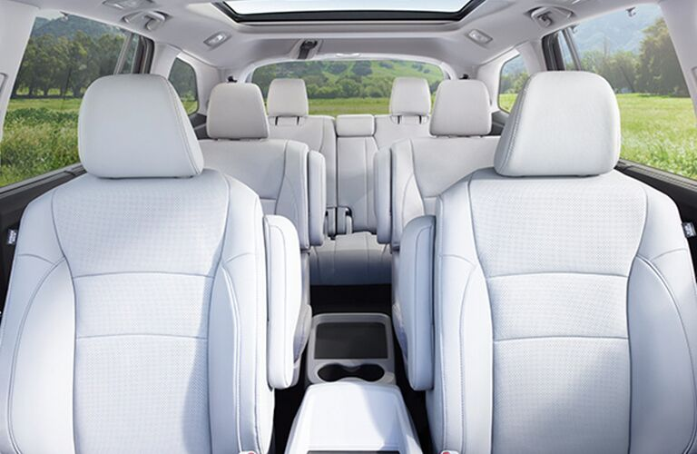 Interior view of the three rows of beige seating inside a 2018 Honda Pilot