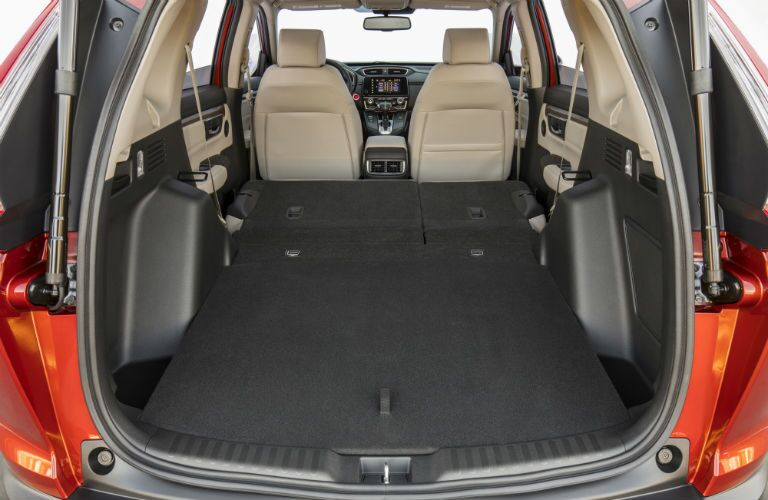 Interior view of a 2018 Honda CR-V with the second row of seating folded down flat