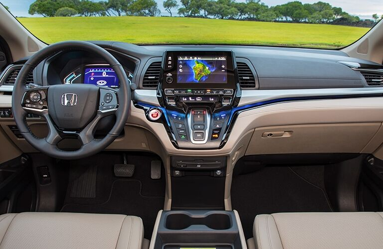 Interior view of the steering wheel and touchscreen inside a 2019 Honda Odyssey
