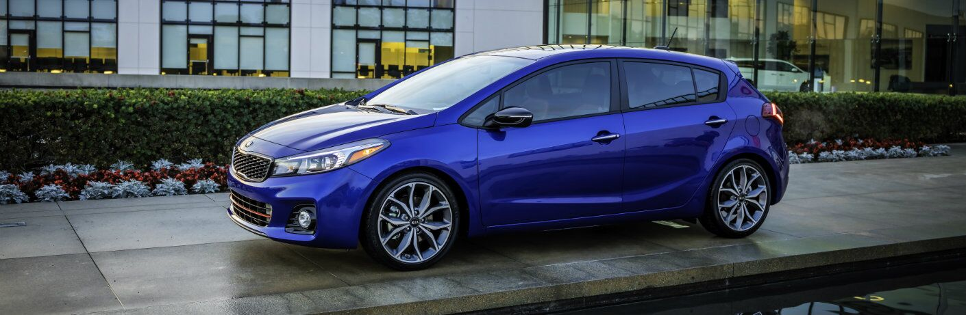side view of a blue 2018 Kia Forte5
