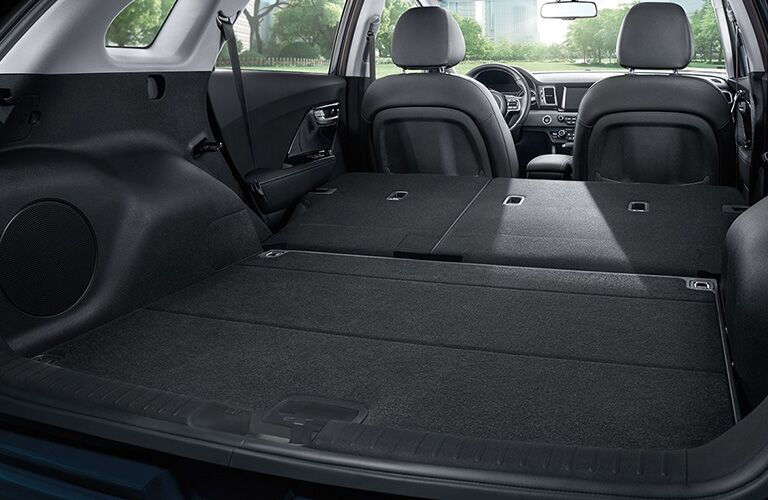 2018 Kia Niro seats folded down shot from the back to show total cargo capacity with city background outside window