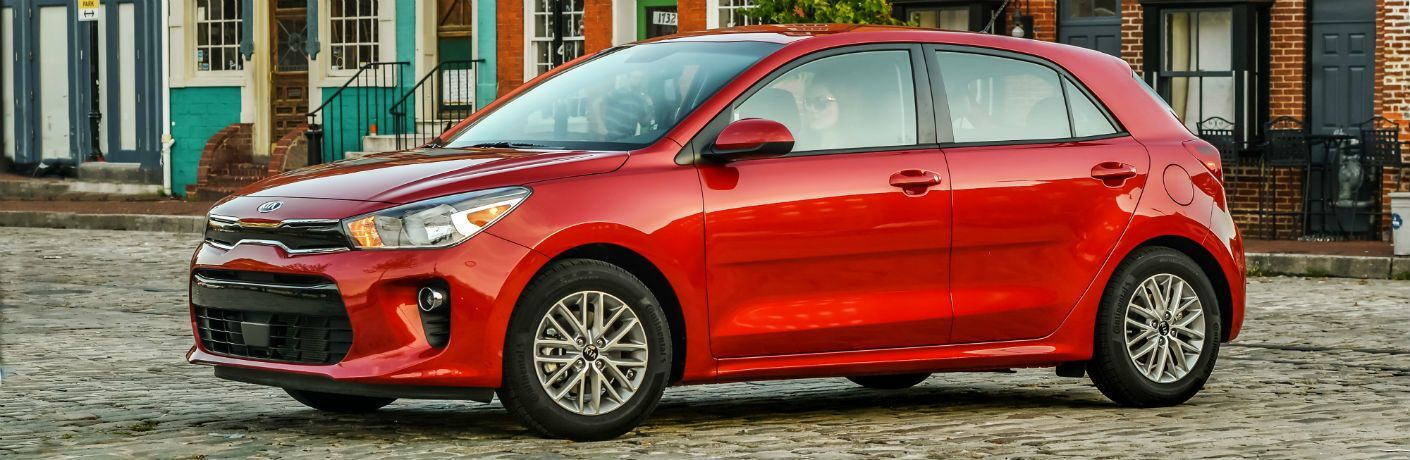 side view of a red 2021 Kia Rio 5-Door