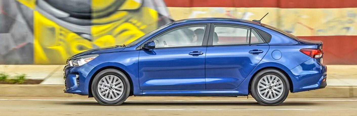 side view of a blue 2021 Kia Rio