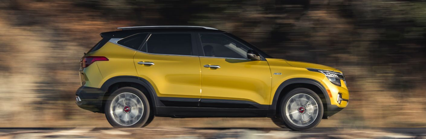 side view of a yellow 2021 Kia Seltos