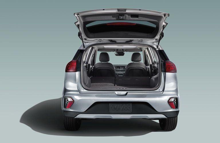 rear view of a silver 2021 Kia Niro with its rear cargo door open