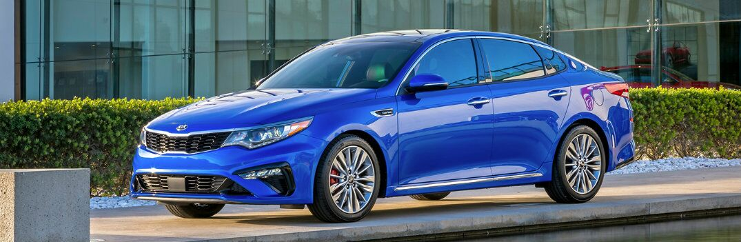 side view of a blue 2021 Kia Optima
