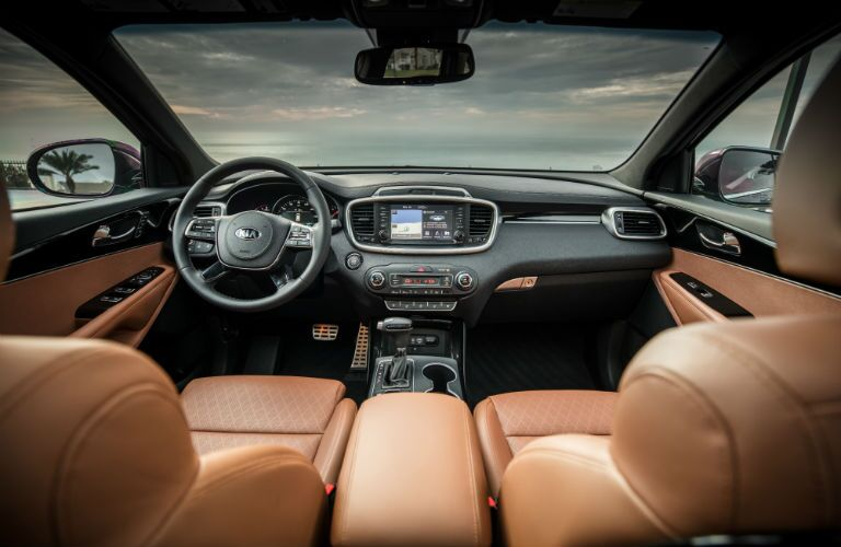 A photo of the dashboard and front seats in the 2019 Kia Sorento.