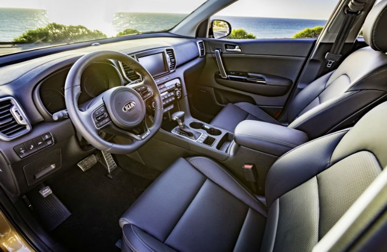 An interior photo of the driver's cockpit in the 2019 Kia Sportage.