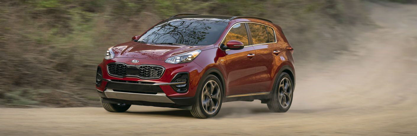 A front left quarter photo of the 2020 Kia Sportage on a dirt road.