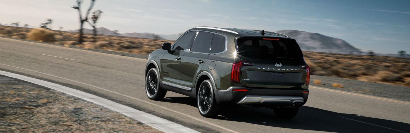 A left rear quarter photo of the 2020 Kia Telluride in motion on the road.