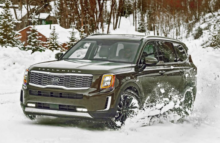 A photo of the 2020 Kia Telluride driving through the snow.