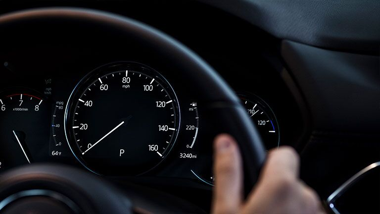 Instrument panel of the 2019 Mazda CX-5 as seen through the steering wheel