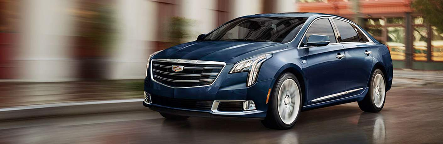 Blue 2018 Cadillac XTS driving down a road