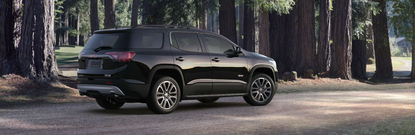2018 GMC Acadia parked near forest
