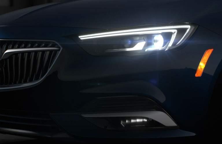 close up of lit headlight on 2018 Buick Regal TourX