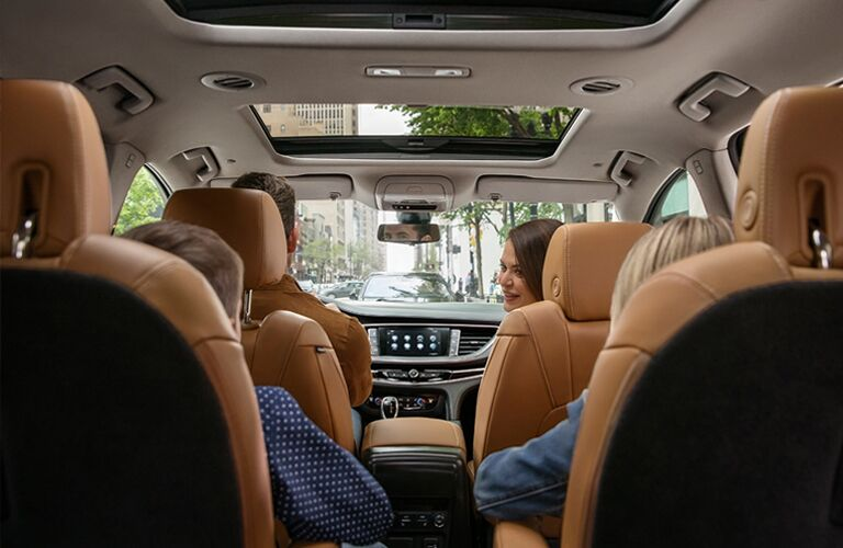 2019 Buick Enclave interior shot from the back showing seating rows and upholstery all filled by a family