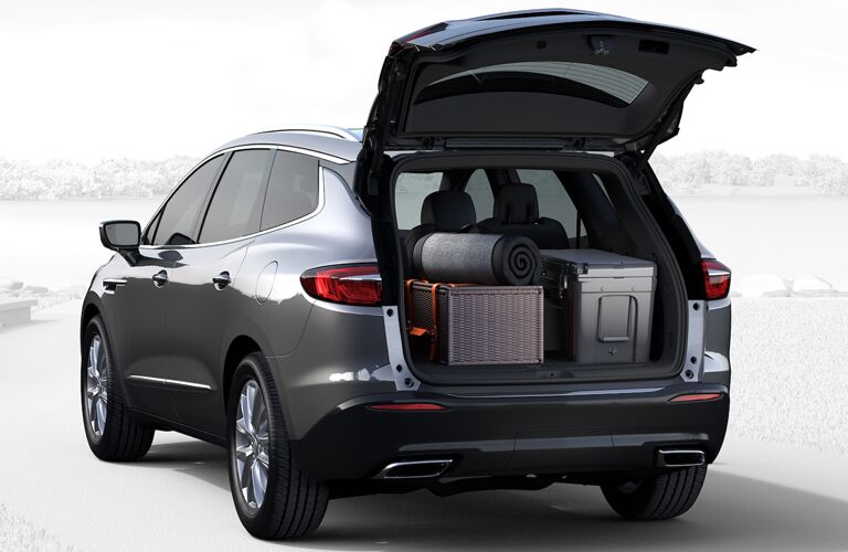 2019 Buick Enclave exterior rear shot with trunk opened and loaded with luggage and equipment