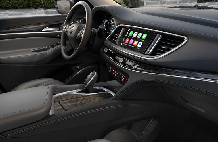 2019 Buick Enclave interior side shot of front seating showing accents and trimming
