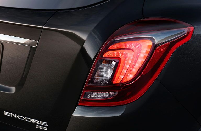 2019 Buick Encore exterior rear closeup shot of taillight design and model badge