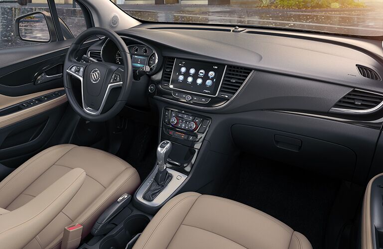 2019 Buick Encore interior overhead shot of front seating, steering wheel, transmission, and dashboard screen and vents