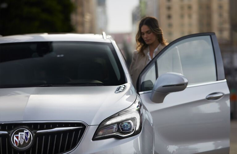 2019 Buick Envision exterior close up shot as a woman enters the driver's side door