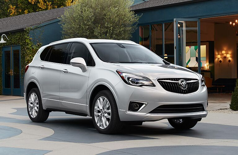 2019 Buick Envision exterior shot parked outside a street with cafes and local shops