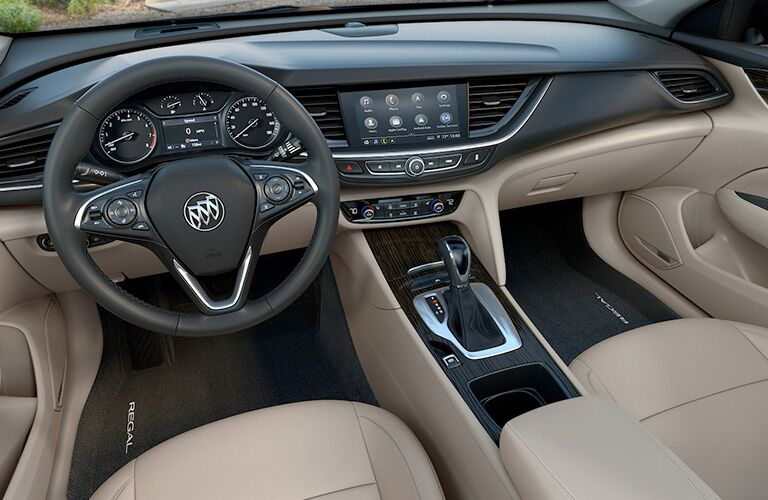 2019 Buick Regal Sportback interior shot of steering wheel, transmission, and dashboard layout
