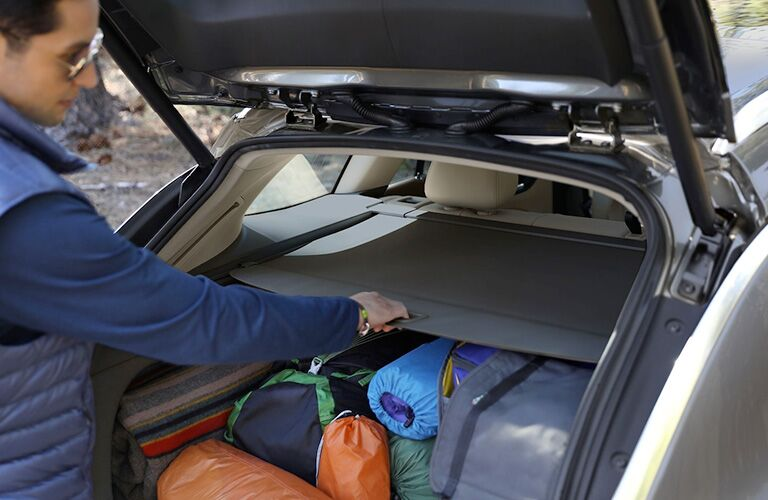 2019 Buick Regal TourX shot of wagon cargo space being loaded up by a family for a trip